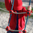 Little boy climbing on rope at playground — Stock Photo