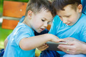 Little boys playing on tablet — Stock Photo