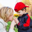 Mother and little boy with flower — Stock Photo