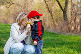 Mother and little boy with dandelion — Stock Photo