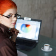 Stock Photo: Redhead businesswomwith laptop
