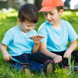 Young boys with wireless smartphone and tablet — Stock Photo