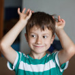 Young boy playing at home — Stock Photo