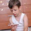 Boy with smartphone at home — Stock Photo
