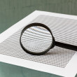 Stock Photo: Law investigation, magnifying glass with document