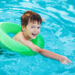 Little boy learning swim with saver — Stock Photo