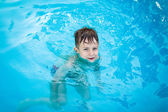 Little happy boy in pool — Stock Photo
