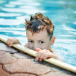 Stock Photo: Little kid hide in pool