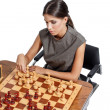 Sexy clever brunette woman playing chess — Stock Photo