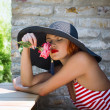 Sexy romantic woman in hat smell flower — Stock Photo