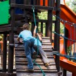 Little brothers playing on jungle gym — Stock Photo