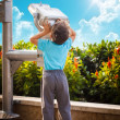 Stockfoto: Little boy with telescope gazing sky
