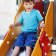 Little boy on slide — Stock Photo
