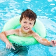 Little caucasian boy learning swim with saver — Stock Photo