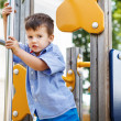Kid slip on pole at jungle gym — Stock Photo