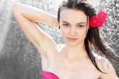 Attractive brunette woman showering — Stock Photo