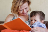 Mom reading tales for son — Stock Photo