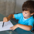 Preschooler boy learn writing letters — Stock Photo