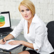 Blonde businesswoman write — Stock Photo