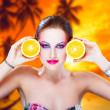 Tropical woman with oranges — Stock Photo