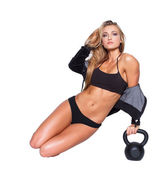 Sexy fitness model sit with kettlebell — Stock Photo