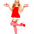 Sexy santa woman holding gift packages — Stock Photo