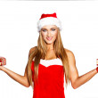 Sexy santa woman holding gifts — Stock Photo