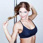 Sexy fresh pole dancer striptease — Stock Photo