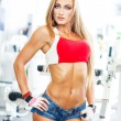 Stock Photo: Sexy blonde fitness model posing