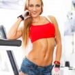 Confident athletic woman posing in gym — Stock Photo
