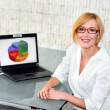 Businesswoman smile at desk — Stock Photo