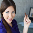 Businesswoman holding sweets — Stock Photo