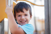 Happy young boy outdoor portrait — Stock Photo