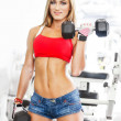Stock Photo: Woman lifting dumbbells