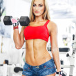 Stock Photo: Woman lifting weights in a training session