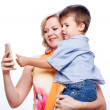 Stock Photo: Mother and son with smartphone