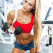 Dumbbell bicep curl by a fitness girl — Stock Photo
