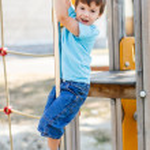 Постер, плакат: Little boy slide down on pole
