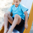 Preschooler boy on slide — Stock Photo