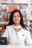 Pharmacist in drugstore — Stock Photo