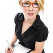 Blonde businesswoman with clipboard — Stock Photo