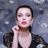 Woman with necklace and bracelet and earrings — Stock Photo