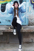 Urban girl with skateboard — Stock Photo