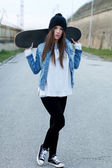 Teenager holding skateboard  — Stockfoto