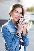 Woman smelling cherry tree flower — Stock Photo