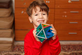 Happy skillful little boy holding toy — Stock Photo