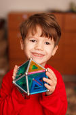 Skillful boy holding toy — Stock Photo