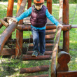 Little boy in cap walking on jungle gym — Stock Photo #45146395