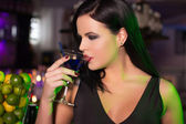 Woman drink cocktail in bar at night — Stock Photo