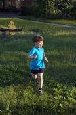 Little caucasian kid run in park — Stock Photo